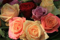 pastel roses in bridal arrangement - stock photo