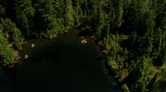 Aerial lake view cascading water mountainside, Rockies - stock footage