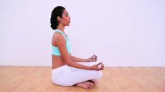 Peaceful woman meditating in lotus position Stock Footage