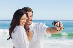 Happy couple taking a photo - stock photo