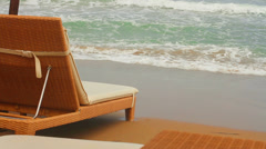 Sun beds by the sea. A peaceful holiday Stock Footage