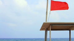 Warning flags on the beach Stock Footage