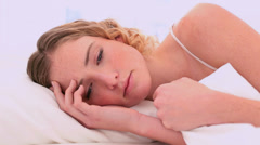 Calm blonde model waking up Stock Footage