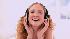 Stock Video Footage of Cute blonde model enjoying music