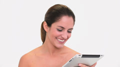 Amused brunette woman using a tablet pc Stock Footage