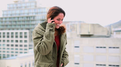 Pleased brunette woman making a phone call Stock Footage
