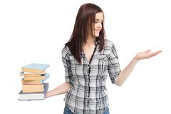 Stock Photo of Happy pretty student holding pile of books