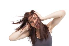 Furious pretty brunette shouting - stock photo