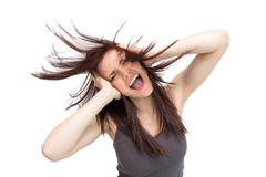 Stock Photo of Furious pretty brunette tossing her hair