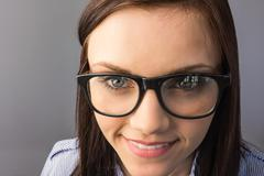 Close up on smiling young  brunette posing Stock Photos