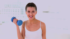 Dynamic attractive woman exercising with dumbbels Stock Footage