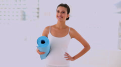 Motivated beautiful woman carrying a mat Stock Footage