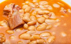 baked beans in a plate detail closeup - stock photo