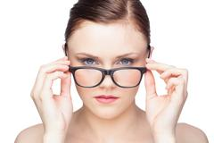 Stock Photo of Content natural model looking over her classy glasses