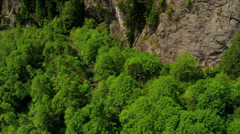 Aerial view remote river  valley extreme terrain wilderness, Rockies - stock footage