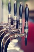 Silver and black beer taps close up - stock photo