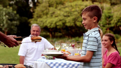 Cheerful family having a barbecue Stock Footage