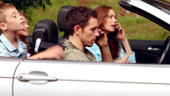 Stock Video Footage of Parents on the phone in a convertible car