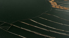 Aerial view Harrison Lake log boom barrier to collect river logs, Rockies, Stock Footage