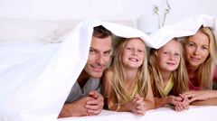 Family under a duvet Stock Footage