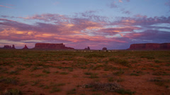 HD 24p wide Monument Valley red clouds day to night time lapse Stock Footage