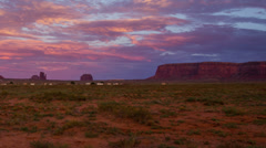 HD 24p tight 1 Monument Valley red clouds day to night time lapse Stock Footage