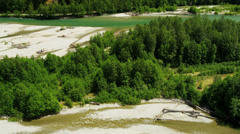 Aerial view river valley turquoise waters driftwood extreme terrain, Rockies Stock Footage