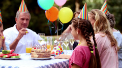 Family celebrating the birthday of a girl Stock Footage