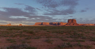 Stock Video Footage of 4K 30p Shadow dance over Monument Valley at sunset