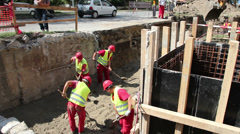 Group of Construction Workers at Work Stock Footage