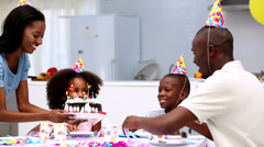 Son blowing out the candles on birthday cake Stock Footage