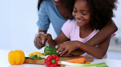 Mother and daughter preparing vegetables Stock Footage