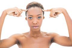 Natural beauty pointing at forehead Stock Photos