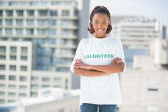 Woman standing with crossed arms - stock photo