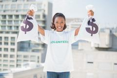 Happy volunteer woman holding money bags Stock Photos