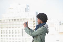 Smiling casual woman taking self picture - stock photo