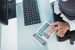 Close up on businesswoman using calculator Stock Photos