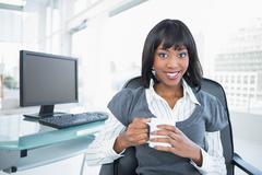 Smiling businesswoman holding mug Stock Photos