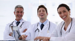 Team of doctors laughing together Stock Footage