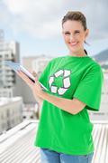 Environmental activist wearing recycling tshirt using tablet - stock photo