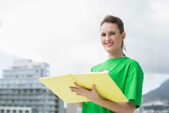 Smiling activist holding notebook Stock Photos