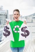 Cheerful woman in green recyling tshirt showing money bags Stock Photos