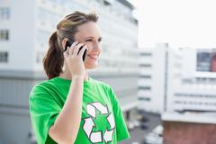 Happy activist talking on the phone Stock Photos