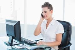 Classy businesswoman having a phone call - stock photo