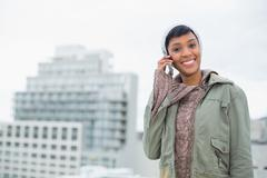 Seductive young model in winter clothes calling someone with her mobile phone Stock Photos
