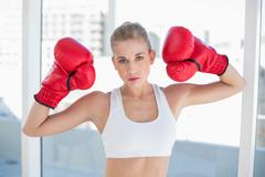Stock Photo of Dynamic young blonde model wearing boxing gloves