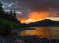 Peach rain at sunset - stock photo