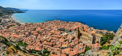 Panoramic view of village cefalu and ocean, sicily Stock Photos