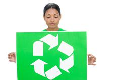 Stock Photo of Content model holding recycling sign