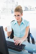 Relaxed elegant businesswoman holding coffee Stock Photos
